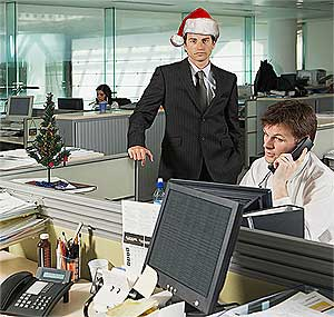 'Twas the day before Xmas Vacation, and all through the office, not a worker was stirring not even Paul The Snitch (right).