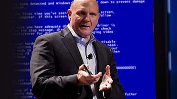 A frustrated Ballmer stands in front of a huge blue screen of death at this year's C.E.S.