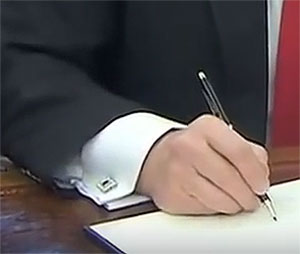 Here the President's hand can be seen to be extremely cramped and blistered.