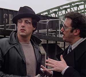 Here Rocky explains things to his thug boss.